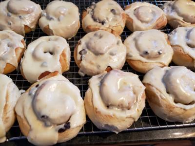 Cinnamon Roll with Raisins, Orange buttercream